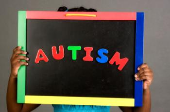 girl-holding-up-an-autism-sign